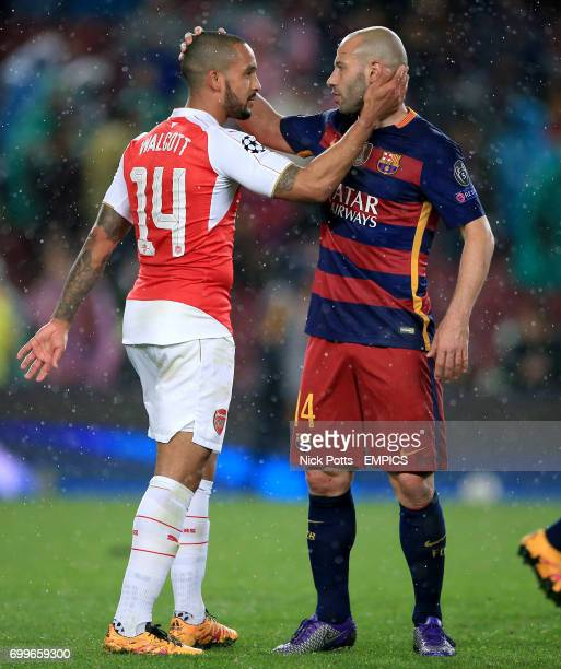 Arsenal's Theo Walcott and Barcelona's Javier Mascherano after the final whistle