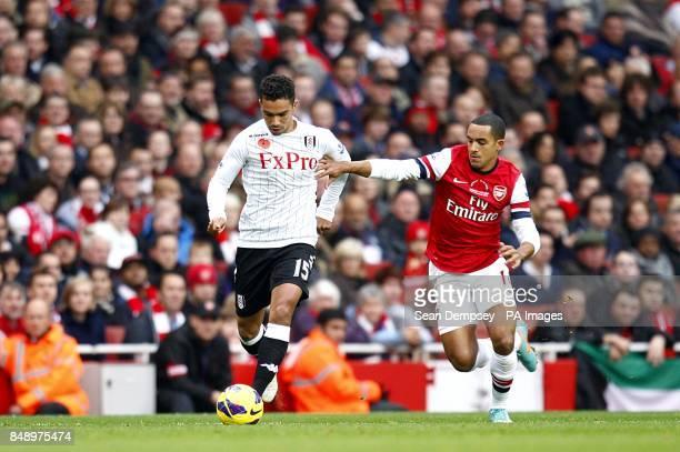 Arsenal's Theo Walcott and Fulham's Kieran Richardson battle for the ball
