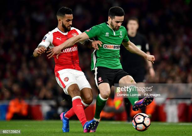 Arsenal's Theo Walcott and Lincoln City's Sam Habergham during the Emirates FA Cup quarter final at The Emirates Stadium London