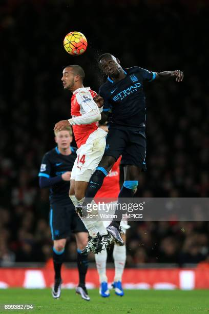 Arsenal's Theo Walcott and Manchester City's Bacary Sagna battle for the ball in the air