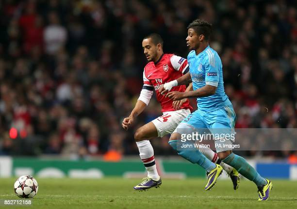 Arsenal's Theo Walcott and Marseille's Mario Lemina battle for the ball