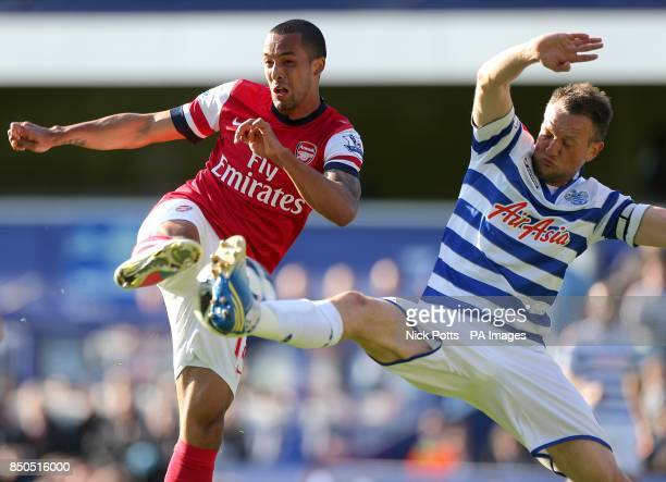 Arsenal's Theo Walcott and Queens Park Rangers' Clint Hill battle for the ball