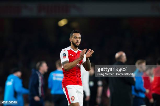 Arsenal's Theo Walcott applauds the fans after the Emirates FA Cup QuarterFinal match between Arsenal and Lincoln City at Emirates Stadium on March...