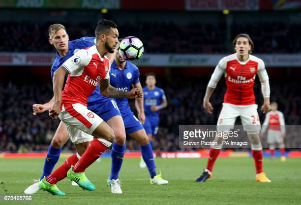 Arsenal's Theo Walcott attempts a shot during the Premier League match at the Emirates Stadium London