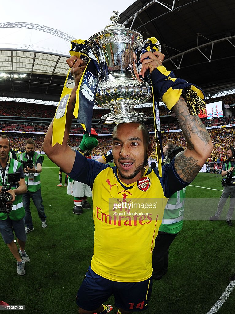 Arsenal's Theo Walcott celebrates after the FA Cup Final between Aston Villa and Arsenal at Wembley Stadium on May 30, 2015 in London, England.