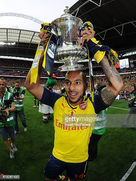 Arsenal's Theo Walcott celebrates after the FA Cup Final between Aston Villa and Arsenal at Wembley Stadium on May 30 2015 in London England
