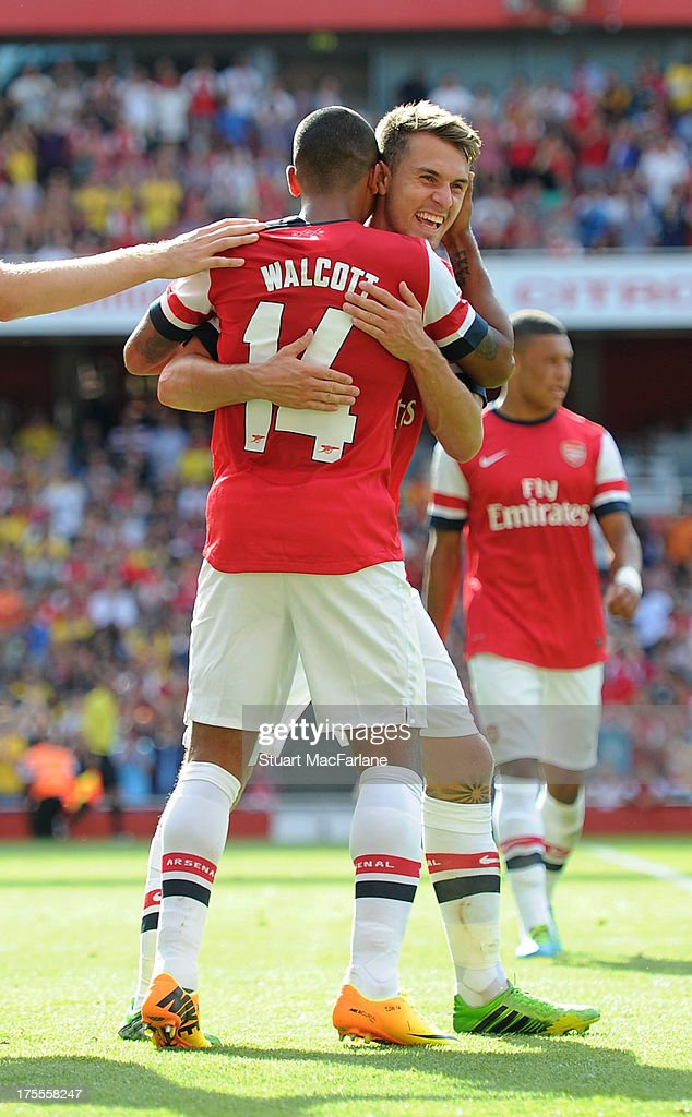 Arsenal's <a gi-track='captionPersonalityLinkClicked' href=/galleries/search?phrase=Theo+Walcott&family=editorial&specificpeople=451535 ng-click='$event.stopPropagation()'>Theo Walcott</a> celebrates his goal with (R) <a gi-track='captionPersonalityLinkClicked' href=/galleries/search?phrase=Aaron+Ramsey+-+Soccer+Player&family=editorial&specificpeople=4784114 ng-click='$event.stopPropagation()'>Aaron Ramsey</a> during the Emirates Cup match between Arsenal and Galatasaray at the Emirates Stadium on August 04, 2013 in London, England.