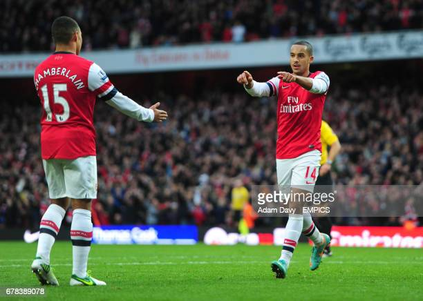Arsenal's Theo Walcott celebrates his goal with team mate Alex OxladeChamberlain against Tottenham Hotspur