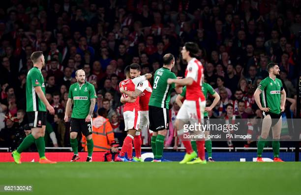 Arsenal's Theo Walcott celebrates scoring his side's first goal of the game during the Emirates FA Cup quarter final at The Emirates Stadium London