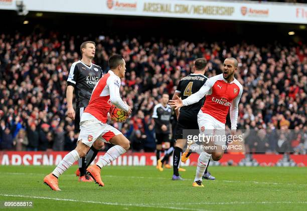Arsenal's Theo Walcott celebrates scoring his side's first goal of the game with teammate Arsenal's Alexis Sanchez