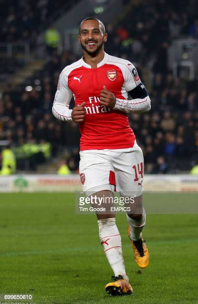 Arsenal's Theo Walcott celebrates scoring his side's fourth goal of the game