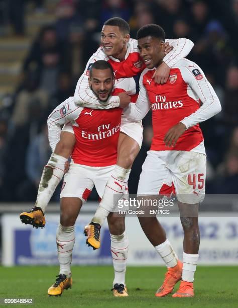 Arsenal's Theo Walcott celebrates scoring his side's third goal of the game