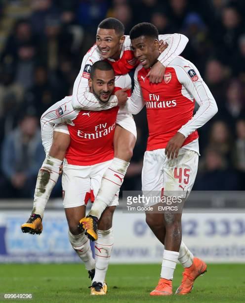 Arsenal's Theo Walcott celebrates scoring his side's third goal of the game with teammates Alex Iwobi and Kieran Gibbs