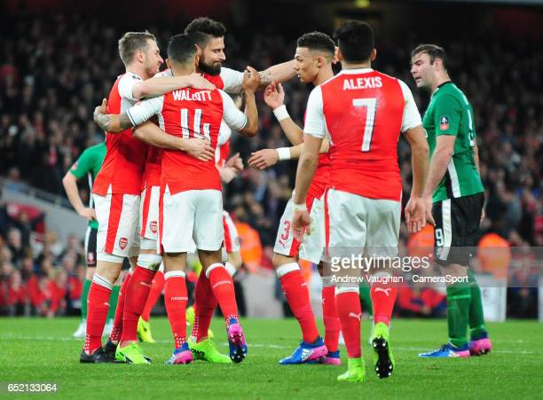 Arsenal's Theo Walcott celebrates scoring the opening goal during the Emirates FA Cup QuarterFinal match between Arsenal and Lincoln City at Emirates...