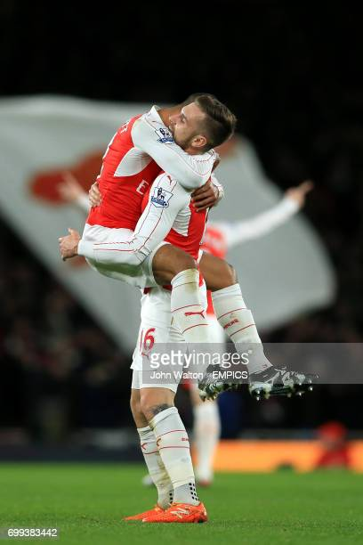 Arsenal's Theo Walcott celebrates scoring their first goal of the game with teammate Aaron Ramsey