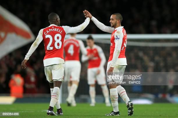 Arsenal's Theo Walcott celebrates scoring their first goal of the game with teammate Joel Campbell