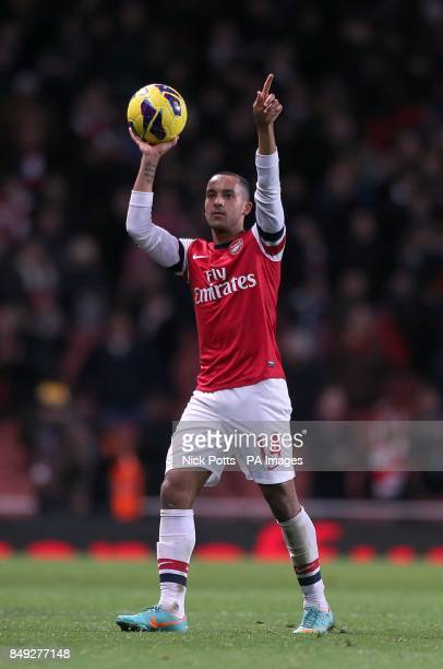 Arsenal's Theo Walcott celebrates with the matchball at the end of the match after scoring a hattrick