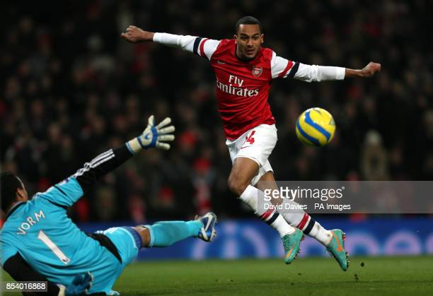 Arsenal's Theo Walcott chips the ball wide of Swansea goalkeeper Michel Vorm during the FA Cup Third Round Replay at the Emirates Stadium London