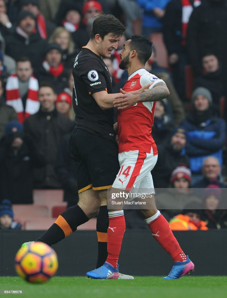 Arsenal's Theo Walcott clashes with Harry Maguire of Hull during the Premier League match between Arsenal and Hull City at Emirates Stadium on February 11, 2017 in London, England.