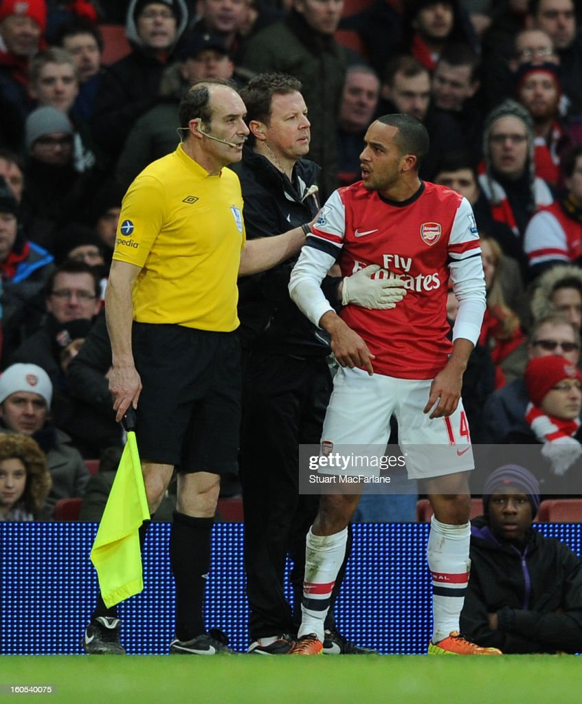 Arsenal's <a gi-track='captionPersonalityLinkClicked' href=/galleries/search?phrase=Theo+Walcott&family=editorial&specificpeople=451535 ng-click='$event.stopPropagation()'>Theo Walcott</a> complains to the assistant referee during the Barclays Premier League match between Arsenal and Stoke City at Emirates Stadium on February 02, 2013 in London, England.