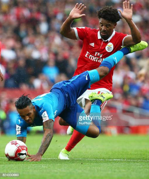 Arsenal's Theo Walcott gets tackled by Eliseu of Sporty Lisboa e Benfica during Emirates Cup match between RB Arsenal against Benfica at Emirates...