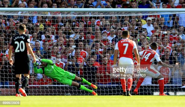 Arsenal's Theo Walcott has a penalty saved by Liverpool goalkeeper Simon Mignolet