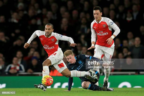 Arsenal's Theo Walcott is brought down by Manchester City's Kevin de Bruyne