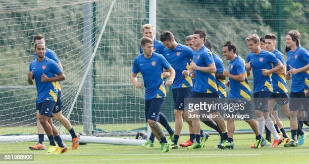 Arsenal's Theo Walcott leads the group during a training session at London Colney St Albans