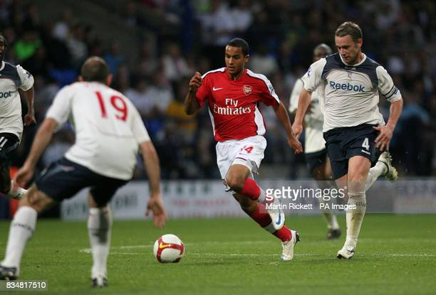 Arsenal's Theo Walcott runs at the Bolton Wanderers' defence