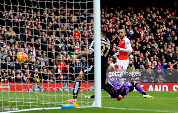 Arsenal's Theo Walcott scores his side's first goal of the game