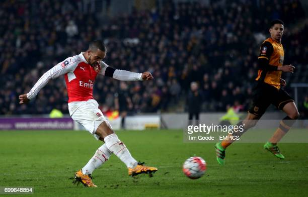 Arsenal's Theo Walcott scores his side's fourth goal of the game