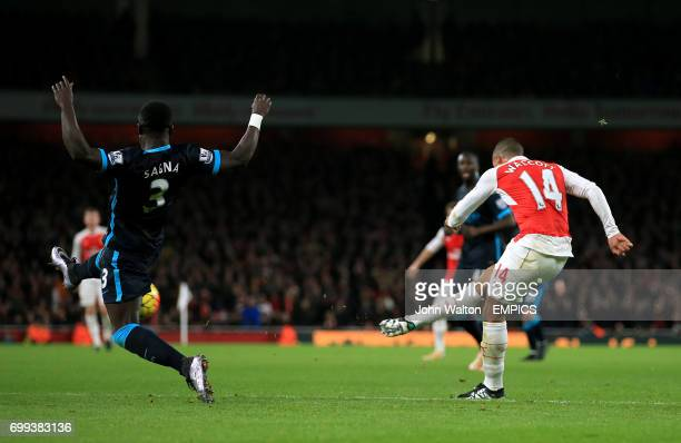 Arsenal's Theo Walcott scores their first goal of the game