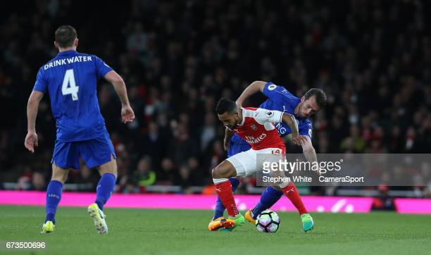 Arsenal's Theo Walcott shields the ball from Leicester City's Christian Fuchs during the Premier League match between Arsenal and Leicester City at...