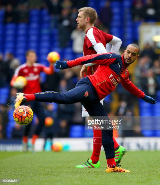 Arsenal's Theo Walcott warms up prior to the match