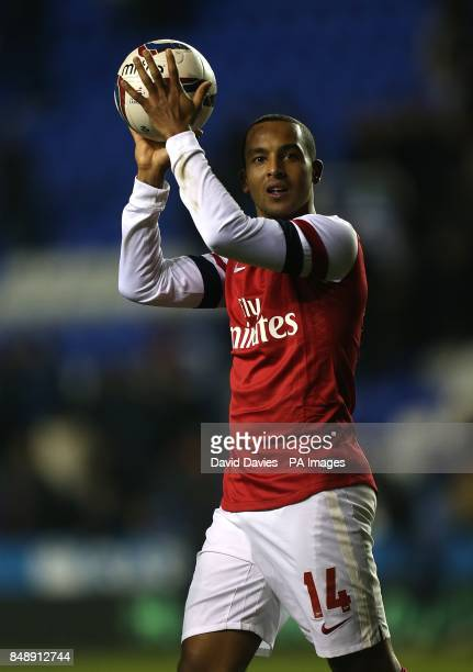 Arsenal's Theo Walcott with the matchball after scoring a hattrick during the match