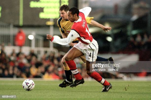 Arsenal's Thierry Henry and Leicester City's Gerry Taggart battle for the ball