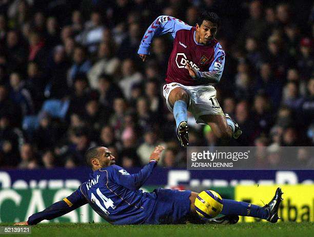 Arsenal's Thierry Henry attempts to tackle Nolberto Solano of Aston Villa during a Premiership match at Villa Park in Birmingham 05 February 2005...