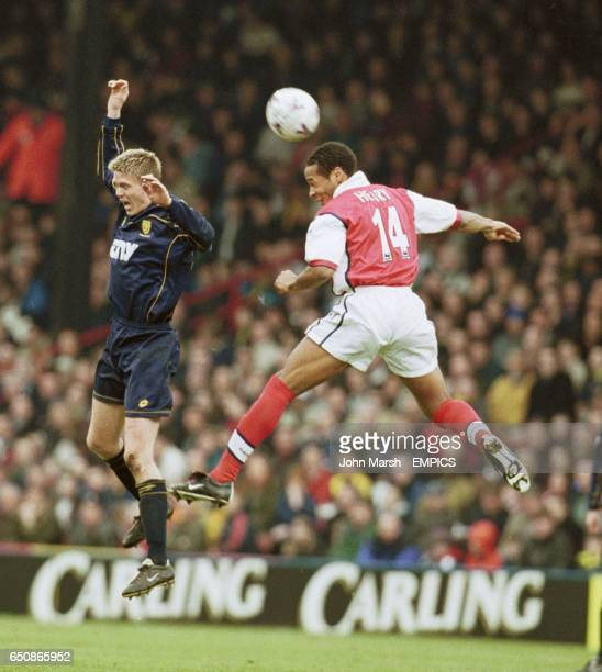 Arsenal's Thierry Henry beats Wimbledon's Trond Andersen to the ball