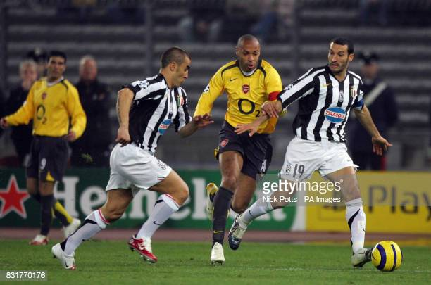 Arsenal's Thierry Henry challenges Juventus' Fabio Cannavaro and Gianluca Zambrotta for the ball during the UEFA Champions League quarterfinal...