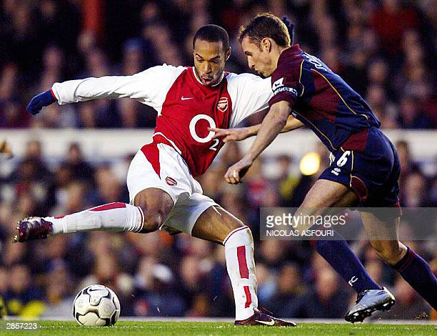 Arsenal's Thierry Henry fights for the ball with Middlesbrough's Gareth Southgate at Highbury in London 10 January 2004 Arsenal won 41 over...