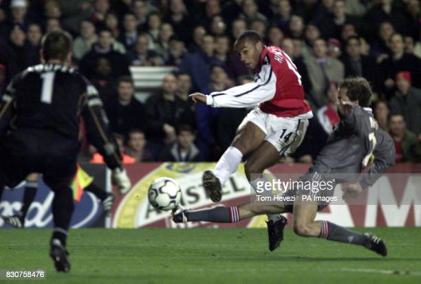 Arsenal's Thierry Henry goes for goal but fails to beats the Lyon 'keeper Gregory Coupet during their Champions League match at Highbury Stadium THIS...