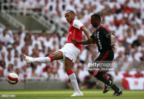 Arsenal's Thierry Henry goes past Ajax Arron Winter to score during the Dennis Bergkamp Testimonial match at Emirates Stadium London