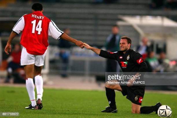 Arsenal's Thierry Henry helps up Juventus' Alessandro Birindelli