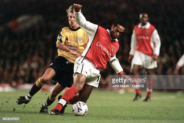 Arsenal's Thierry Henry is chased by Leicester City's Robbie Savage