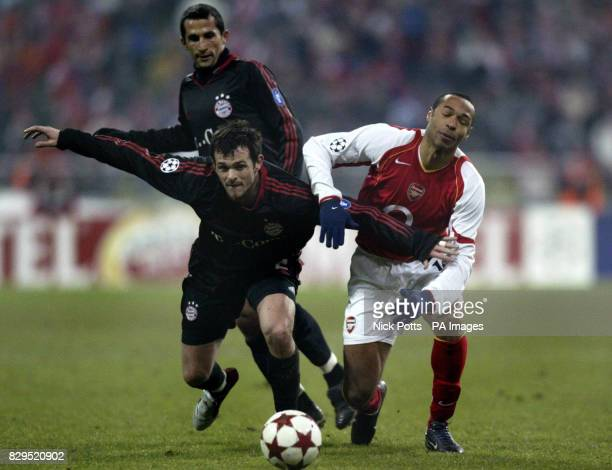 Arsenal's Thierry Henry is held off from the ball by Bayern Munich defender Willy Sagnol