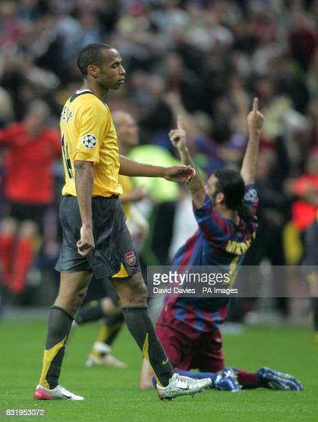 Arsenal's Thierry Henry looks dejected after Barcelona's Rafael Marquez celebrates victory
