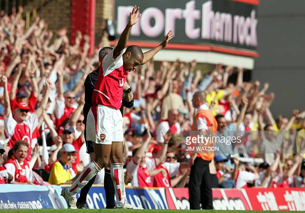 Arsenal's Thierry Henry raises hands at the final whistle as Arsenal wins the Premiership Championship and defeat's Leicester City after their...