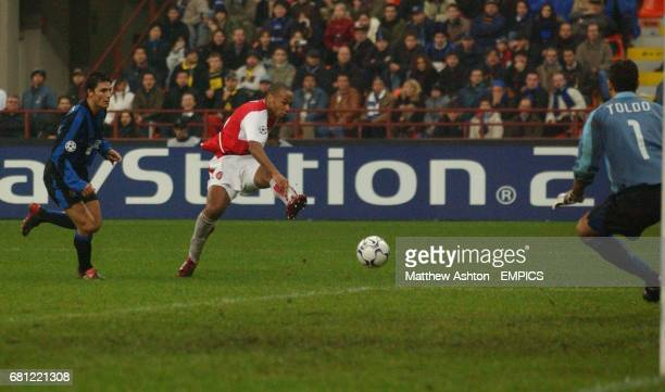 Arsenal's Thierry Henry scores his teams 3rd goal past Inter Milan's goalkeeper Francesco Toldo