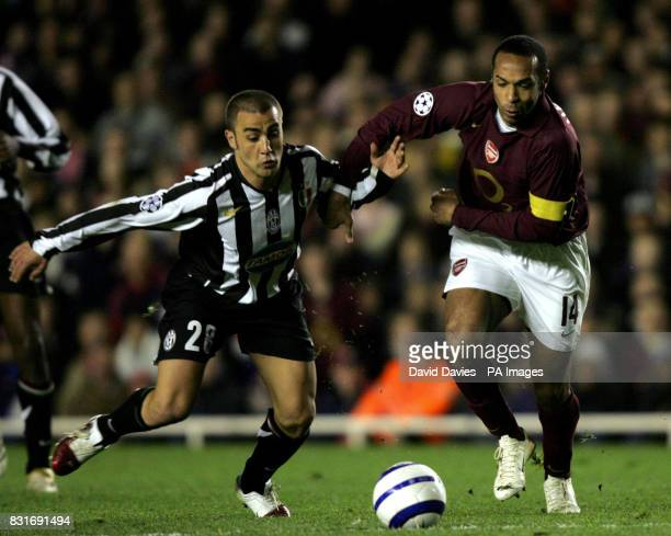 Arsenal's Thierry Henry tussles with Juventus' Fabio Cannavaro during the UEFA Champions League quarterfinal match at Highbury London Tuesday March...