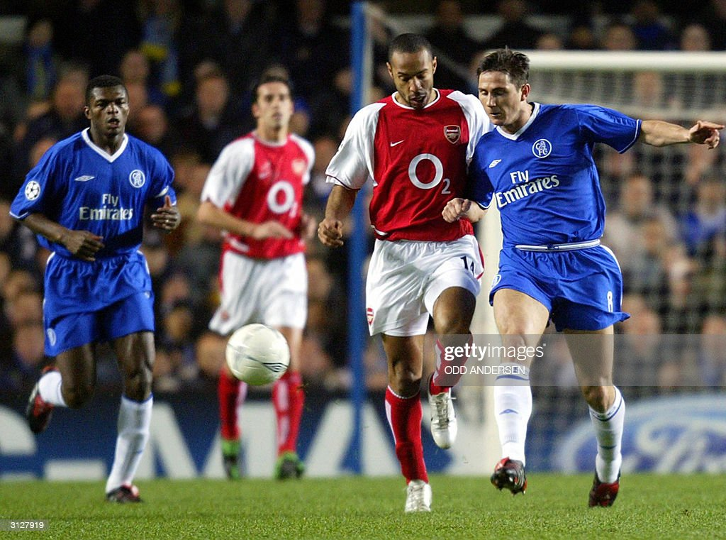 Arsenal's Thierry Henry (C) vies for the ball with Frank Lampard of Chelsea during their Champions league quarter final first leg clash at Stamford bridge in London,24 March 2004.